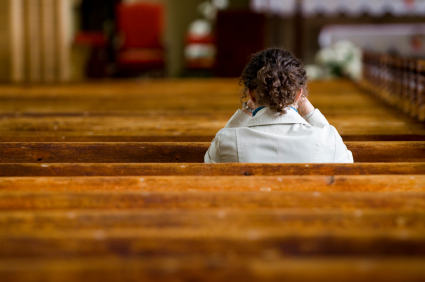 Young-Woman-Praying-in-Church