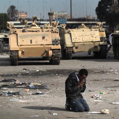 Year-A-Epiphany-07-Man-Praying-in-Front-of-Tanks-Square